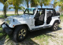 white jeep 4 door our jeeps