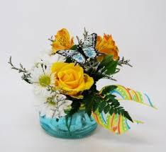butterfly landing flower arrangement in mankato mn drummers