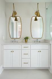 brass bathroom mirrors brass vanity mirror with brass swing arm sconce transitional