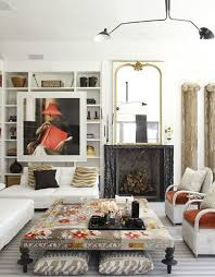 eclectic living room with cement fireplace by lukas machnik
