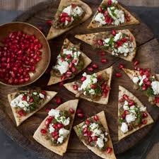 canap aubergine crispy pitta chips topped with aubergine pomegranate and mint