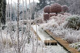 frost covered garden in winter broughton grange landscape