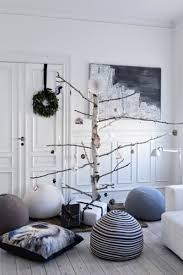 14 gorgeous scandinavian living rooms dressed for christmas non pine christmas tree
