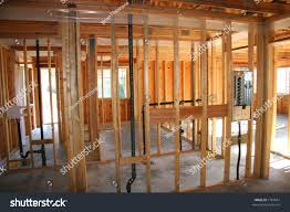 Plumbing A House by Framed Walls House Come Together Basic Stock Photo 1787667