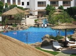 hotel piscine dans la chambre piscine devant la chambre photo de domina coral bay prestige