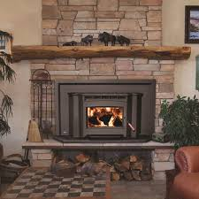interior classic wood burning fireplace insert on hardrock wall