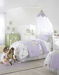 pottery barn girl room ideas white and purple strikes again in this adorable girls shared bedroom