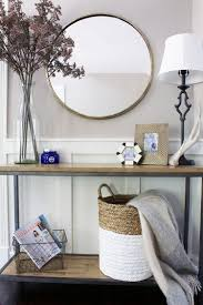 sofa table with lavender round mirror rattan basket wire