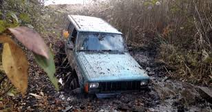 mud jeep cherokee towing company charges jeep owner 48 000 for getting stuck in mud