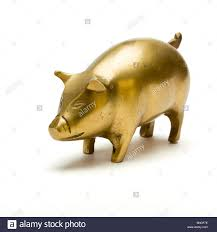 3 4 view of solid brass metal pig ornament from low perspective