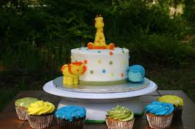 jungle baby shower cakes yellow blue and green jungle baby shower cake and cupcakes