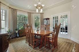 dining room in suburban home with french doors stock photo