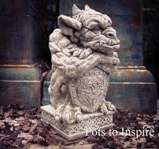 sparta shield gargoyle stoneware garden ornament woodside garden