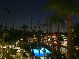 the beverly hills hotel poolside in the evening