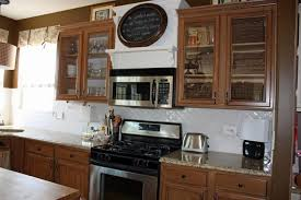 Glass Front Kitchen Cabinet Door Marble Contertops Electric Stove And Oven Wooden Kitchen Cabinets