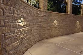retaining wall lights under cap stucco with stone accent retaining wall wall lighting mokena wall