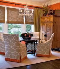 impressive dining room armoire with beige fabric chairs pendant