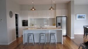 white on white overhead cupboards waterfall island no handles