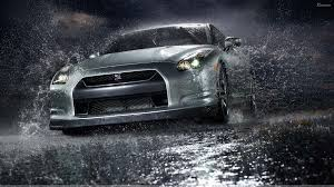 black nissan gtr wallpaper nissan gtr front pose after rain in black night wallpaper