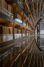 xl muse u0027s black mirror glass reflects books in chinese library