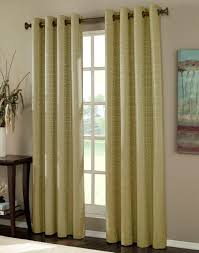 beautiful curtain nuanced in green installed on simple wooden