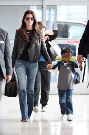sandra bullock son a stylish sandra bullock and her son louis jet out of new york
