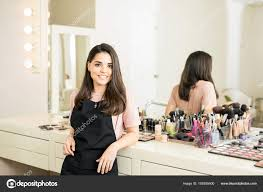 looking for makeup artist makeup artist in beauty salon stock photo tonodiaz 155935400