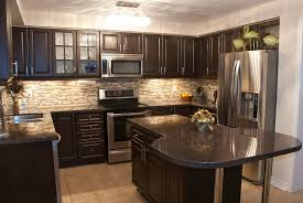 transitional kitchen with black cabinets copper vent hood black