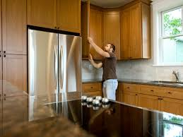 how to hang a cabinet to the wall how to install kitchen cabinets hgtv