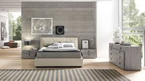 dark gray bedroom walls urban camouflage bedcover white wooden