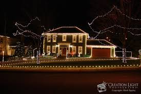 what do christmas lights represent house decorated with christmas lights creation light photography