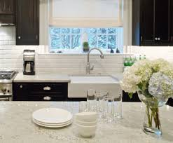 granite countertop white kitchen cabinets with brown walls