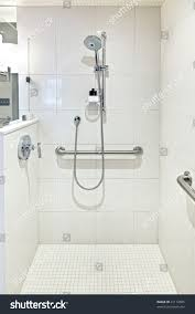 accessories white tile wall with rain shower and handicap showers
