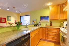 yellow kitchen wood cabinets kitchen with wood cabinets and bright green walls