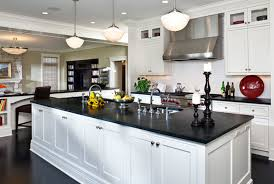 classical pendant lamp on black kitchen islandbined with modern