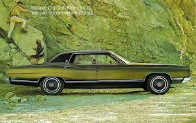 green station wagon with wood paneling not really my car but the first car i got to drive after getting