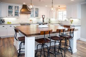 white kitchen wood island our 55 favorite white kitchens hgtv