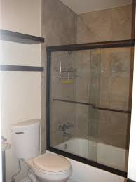 tub shower combo with sliding glass door by black floating over