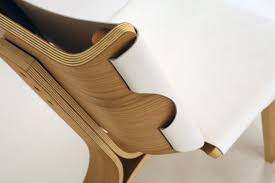 backrest detail of stylish chair made of bent plywood and leather