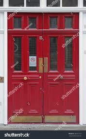 red double door entrance pub stock photo 482471317 shutterstock