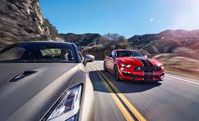 nissan sports car blue godzilla vs voodoo child nissan gt r takes on ford mustang shelby