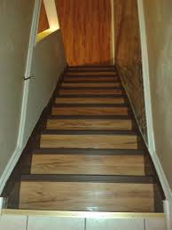 re did the basement stairs in the same vinyl plank flooring that i