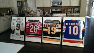 framed hockey jerseys for the basement bought frames from ikea