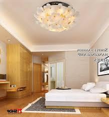 excellent bedroom ceiling light fixtures dark brown armchair and