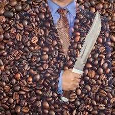 Coffee War coffee war businessman holding knife on coffee stock photo image