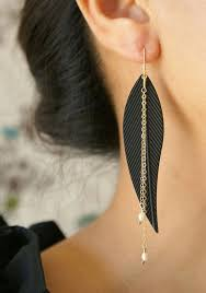 one side feather earring 10 statement earrings for your wedding mywedding