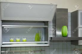 kitchen cabinet with green cups and dishes stock photo picture