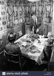 thanksgiving holiday images 1950s family of 5 thanksgiving holiday meal mom dad man woman 3