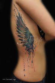 awesome watercolor one wing by freestyle tattoos