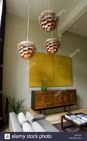 Livingroom Light Living Room With Sofa And Louis Poulsen Artichoke Lights Stock